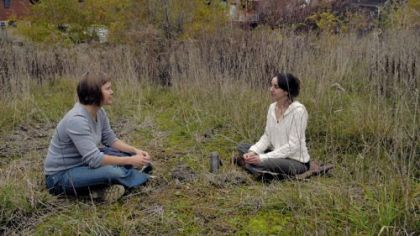 Juliette Jones, left, and Michelle Czolba sit at the site of the proposed Pittsburgh Food Forest on Second Avenue in Hazelwood. The two are planning to grow trees, shrubs and perennial herbs to help feed the community with fresh food.