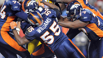 Steelers quarterback Ben Roethlisberger is gang tackled by the Broncos during Denver's 31-28 home win in the 2007 season.