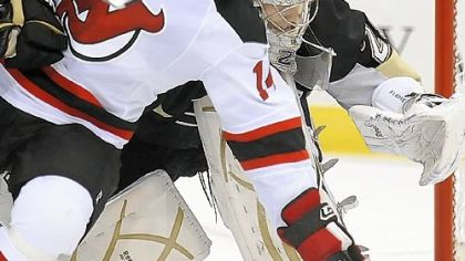 The Devils' Tim Sestito collides with Penguins goalie Marc-Andre Fleury in the second period last night at Mellon Arena.