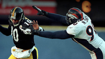 Steelers quarterback Kordell Stewart tries to elude Broncos defensive end Neil Smith during the 1997 AFC Championship Game at Three Rivers Stadium.