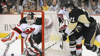 Martin Brodeur makes save against Evgeni Malkin en route to his record-setting 104th shutout.