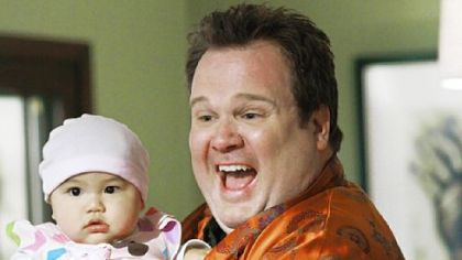 "In ""Modern Family,"" Eric Stonestreet portrays Cameron, half of a gay couple who have adopted a baby from Vietnam."
