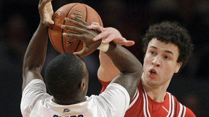 Indiana guard Jeremiah Rivers fouls Pitt guard Ashton Gibbs as he shoots in the first half.