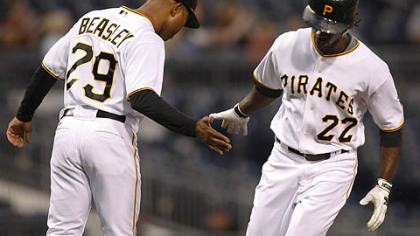Pirates outfielder Andrew McCutchen is greeted by third base coach Tony Beasley after hitting a home run last night.