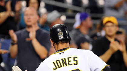Pirates outfielder Garret Jones is congratulated after hitting a solo home run off Padres starting pitcher Wade LeBlanc in the first inning.