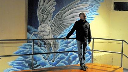 Scott Noxon, near a mural of Pegasus, first visited the bar in 1984, and bought it in 2005.
