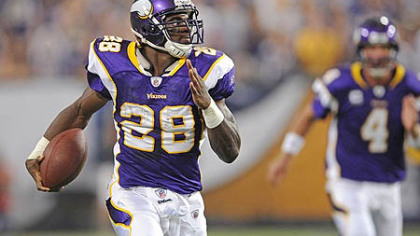 Vikings running back Adrian Peterson, right, and quarterback Brett Favre.