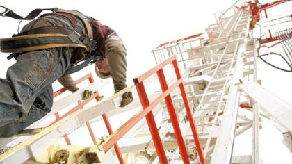 Joseph Bolin on Wednesday climbs down from a natural gas drilling rig derrick contracted by Range Resources in Washington County.