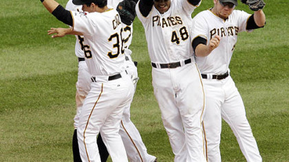 Pirates players celebrate an 11-1 win against the Dodgers.