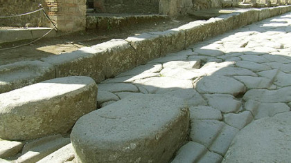 The raised stones in Pompeii are just high enough to allow pedestrians to cross water-filled streets but low enough to allow chariots to lumber past without any problems.