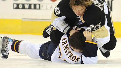 Ruslan Fedotenko gets the drop on Atlanta&#039;s Colby Armstrong early in the game last night at Mellon Arena.