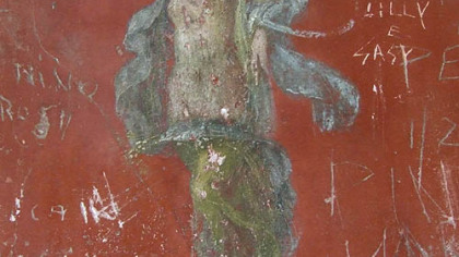 Pompeii is so well preserved that some of its artwork, such as this delightful fresco of a dancing woman in the House of the Lararium of Achilles, is clearly visible. But as the modern graffiti makes clear, not everyone sees its value.