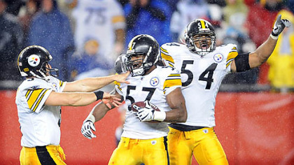 Steelers special teamer Keyaron Fox, center, celebrates after recovering a fumble by the Patriots' Matthew Slater on a kickoff in the third quarter on Nov. 30.