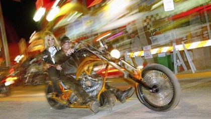 A chopper cruises down Main Street during the first weekend of the 2006 Bike Week in Daytona Beach, Fla. The event brings motorcycle riders and fans from all over the world the first full week of March each year.