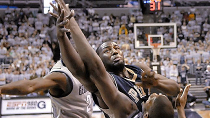 DeJuan Blair muscles his way over Georgetown's Greg Monroe for one of his 17 rebounds yesterday in Pitt's dominating performance at the Verizon Center in Washington.